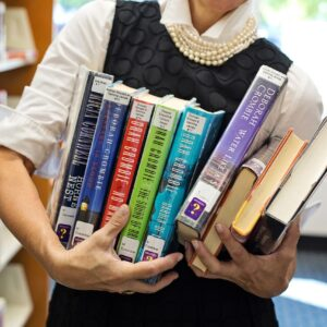 library, books, woman holding books